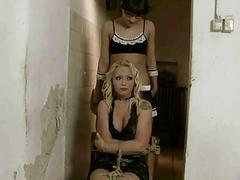 Young mistress punishing mature blonde