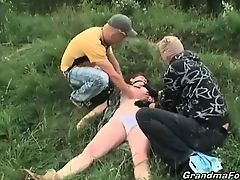 Two dudes abusing brunette granny