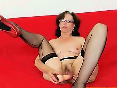Slavena fucks her cunt and standing in panty-hose and heels