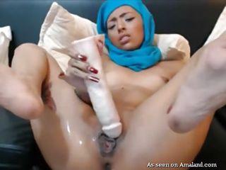 girl in hijab takes a huge dildo