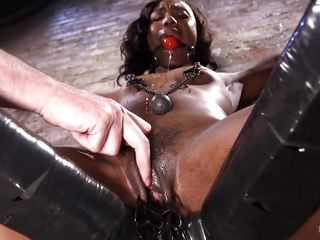 with ball gag in her mouth and clamps on the nipples