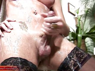 pretty t-girl drowns her shecock in milk and cums in closeup