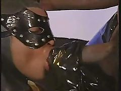 black bitch in latex catsuit sucks big black cock for facial