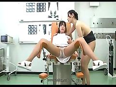 Nurse and doctor are giving each other an exam of their pussies