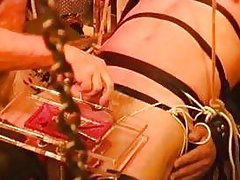This guy is bound and receiving some serious cock torture form his master