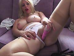 British slut Lucy G plays with she is on a purple sofa